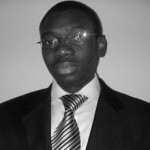Michael Uzoigwe, Associate